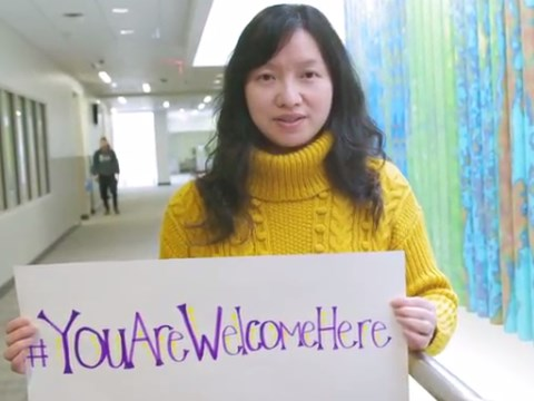 WCU Staff Holding a You Are Welcome Sign